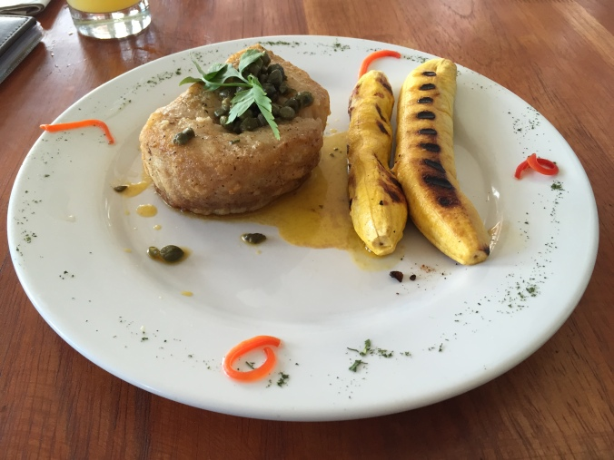 Broiled paiche with grilled plantains at Fitzcarraldo Restaurant in Iquitos.