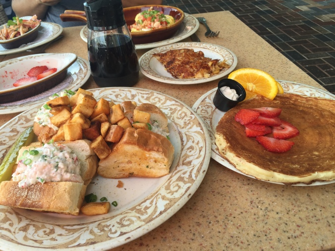 The shrimp and lobster sliders and buttermilk pancake at Another Broken Egg Cafe.